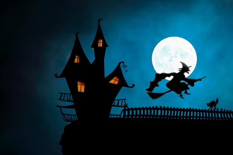 Spooky cartoon house with witch flying past the moon