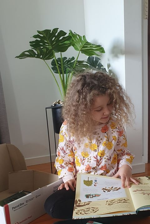 Hallie - Face of the Library, reading books from Casey Cardinia Libraries